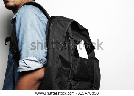 Young man with backpack isolate white background.