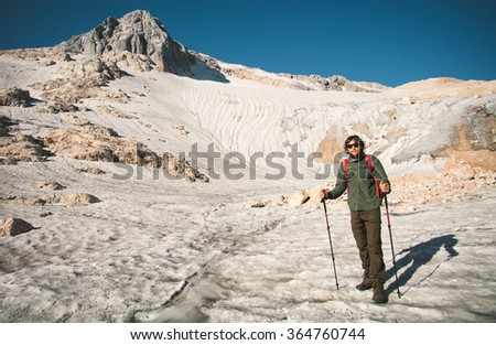 Young Man with backpack mountaineering glacier outdoor Travel Lifestyle concept mountains on background