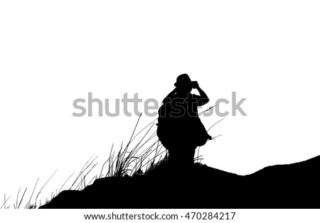 Young man with backpack standing on cliff  black and white style