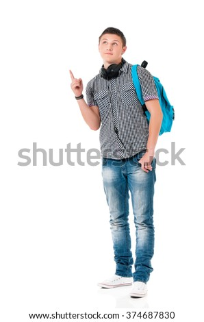 Young man with bag shows forefinger on something, isolated on white background - stock photo