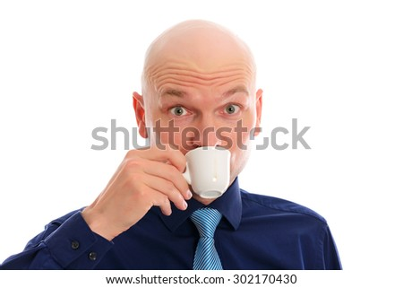 young man with bald head in front of white background drinking espresso