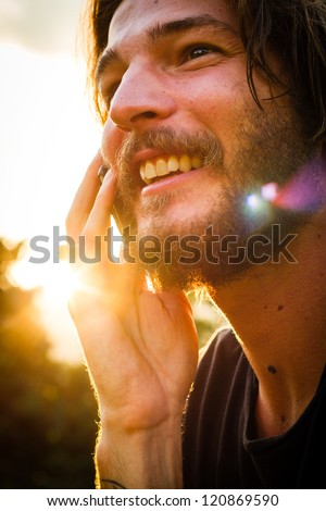 young man with beard and mobilephone