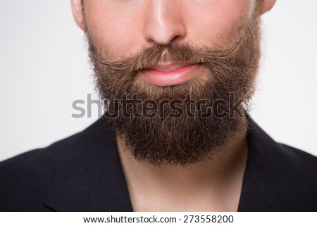 Young man with beard smiling on white - stock photo