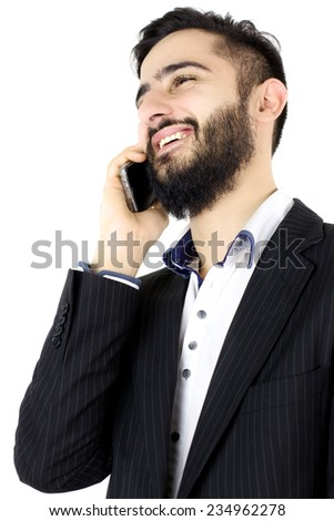 Young man with beard talking on the phone