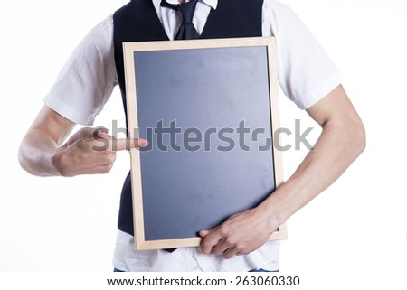Young man with blackboard on white background