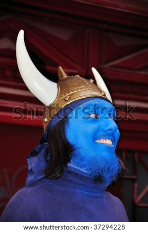 Young man with blue mask on his face - stock photo