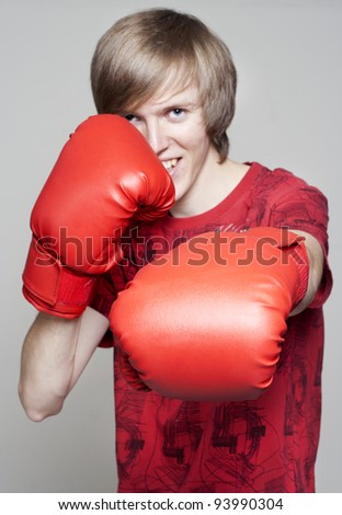 Young man with boxing gloves - stock photo