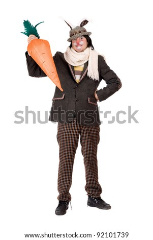 Young man with carrot dressed in a suit rabbit - stock photo