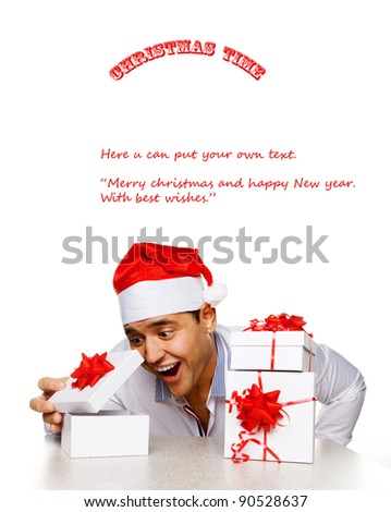 Young man with christmas gifts, isolated on white - stock photo