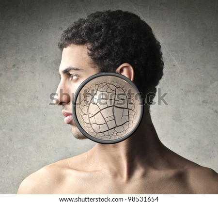 Young man with closeup of his wrinkled skin - stock photo