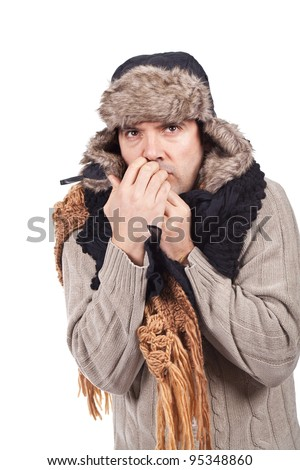 young man with cold wearing a scarf and a bonnet - stock photo