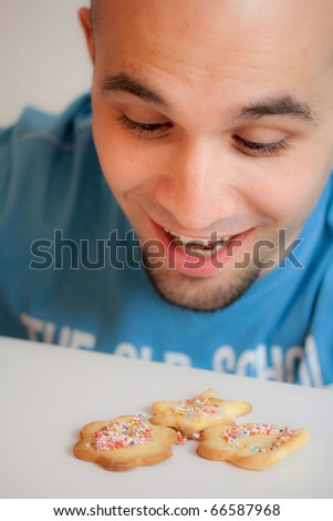 Young man with cookies - stock photo