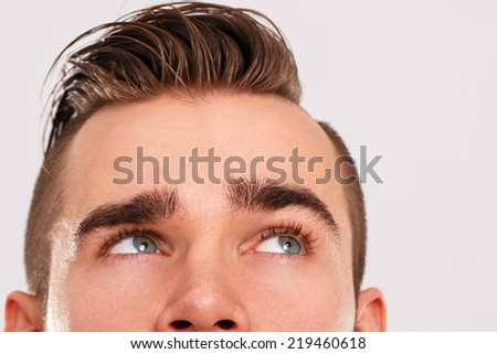 Young man with cute face - stock photo