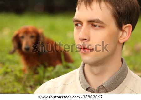 Young man with dachshund  outdoor - stock photo