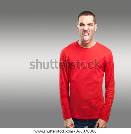 Young man with disgust gesture - stock photo