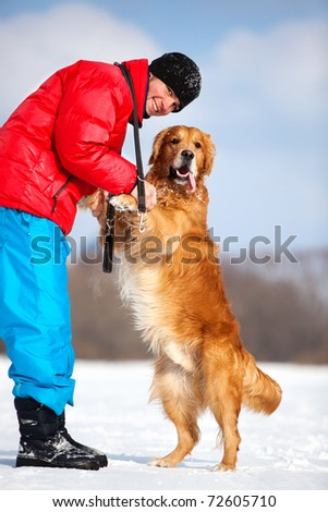 Young man with dog outdoors. - stock photo