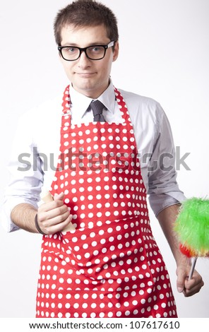 Young man with duster smiling. - stock photo