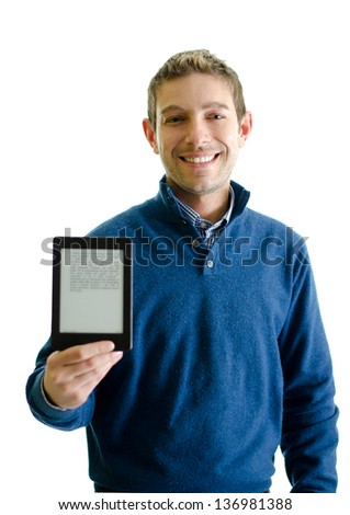 Young man with ebook reader (e-reader) in his hand, smiling. Isolated on white - stock photo