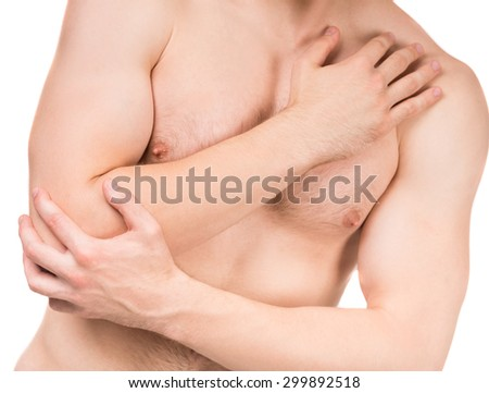 Young man with elbow pain isolated on white background. Close-up.