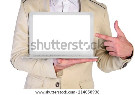 young man with elegant suit pointing blank screen on white background - stock photo