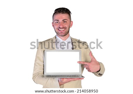 young man with elegant suit pointing laptop on white background - stock photo