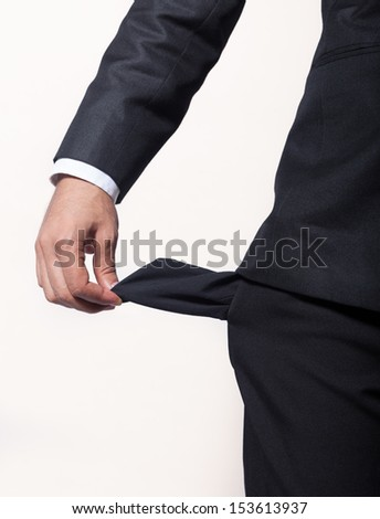Young man with empty pocket