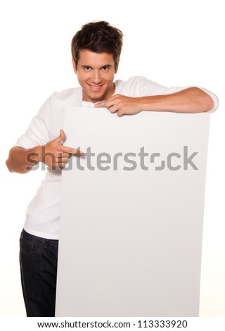 young man with empty poster to advertise the opening and offers - stock photo