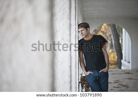 Young man with expression of sadness - stock photo