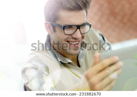 Young man with eyeglasses in training class - stock photo