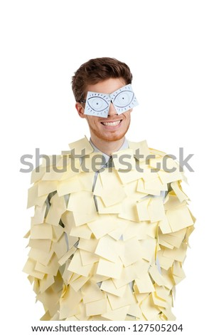 Young man with eyes painted on stickers, covered with yellow sticky notes