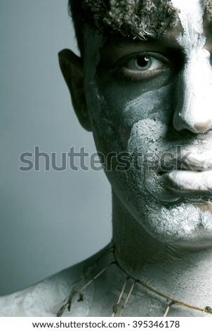 young man with fantasy makeup - half face close up - stock photo