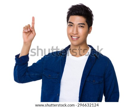 Young man with finger point up - stock photo
