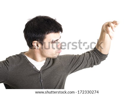 Young man with forefinger and thumb put together on a white background