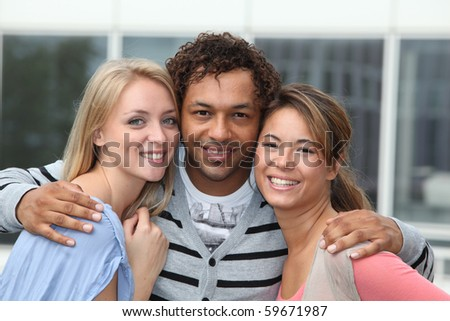 Young man with girl friends