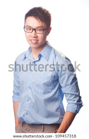 Young man with glasses standing over white background - stock photo
