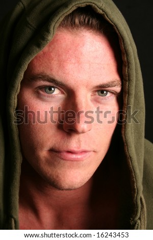 young man with green eyes in hoody