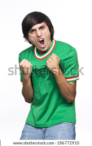 Young Man with green shirt or jersey  Shouting and feasting I fill of happiness and emotion on white background - stock photo