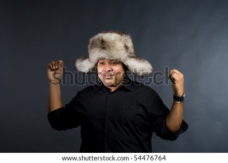 Young man with grey fur hat
