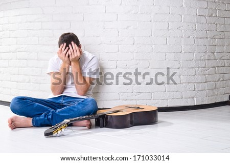 young man with guitar - stock photo