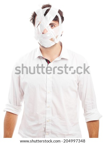 young man with head covered by tape - stock photo