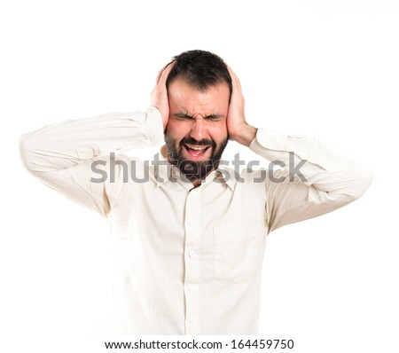 Young man with headache over white background - stock photo