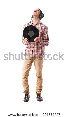 young man with headphones and vinyl