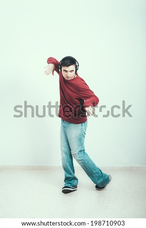 Young man with headphones dancing.