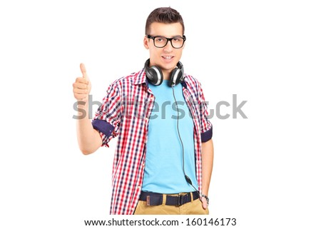 Young man with headphones giving a thumb up, isolated on white background