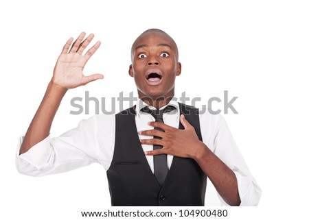 young man with his arms up and looking surprised - stock photo