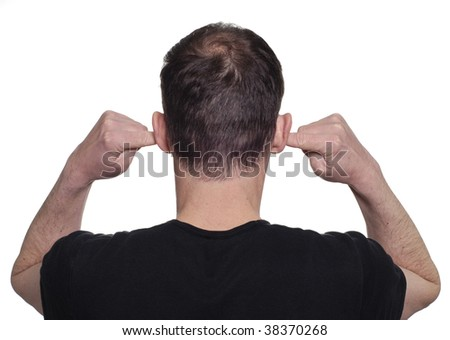 Young man with his fingers in his ears to block out noise.