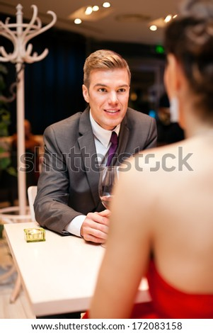 Young man with his love woman at restaurant - stock photo