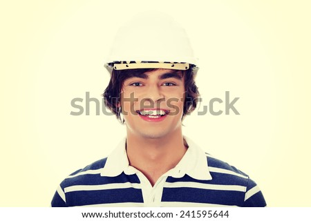 Young man with house's model. Isolated on white background. - stock photo