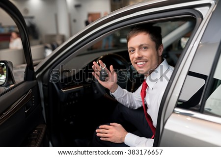 Young man with keys of car