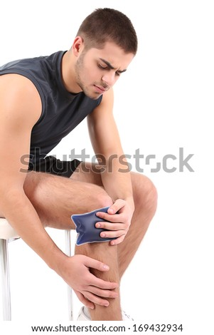 Young man with knee pain, isolated on white - stock photo